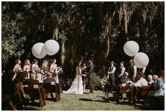 vero beach outdoor wedding ceremony- balloons as wedding decor - rustic outdoor wedding