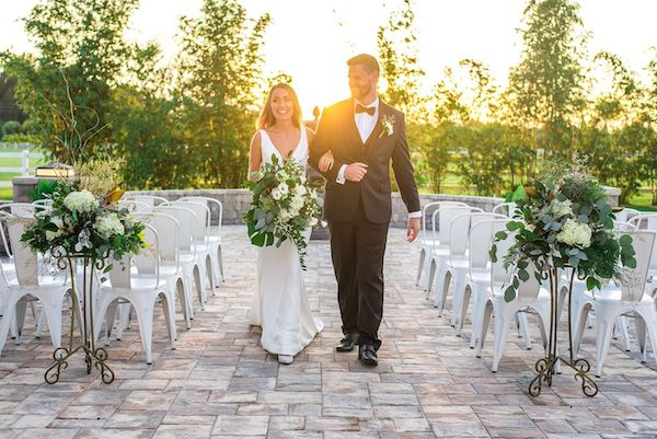 Two Chicks and a Pot – Dragonfly Farms – Palm Bay Wedding Venue – Palm Bay Caterer-outdoor wedding ceremony with with flowers